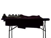 Hot lastones massage therapy silhouette Stock Photo