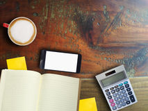 Hot late and smartphone and book and calculator Royalty Free Stock Photo