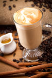 Hot latte. With sugar and cinnamon stick Stock Photo