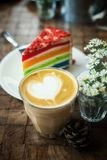 The hot latte art coffee with Colorful cake. In coffee shop royalty free stock photos