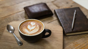 Hot latte art coffee cup on table, vintage and retro style Royalty Free Stock Image