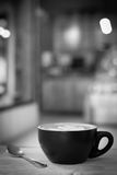 Hot latte art coffee cup on table, vintage and retro style black Royalty Free Stock Image