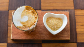 Hot latte art coffee with newspaper on wooden table, vintage and Stock Photo