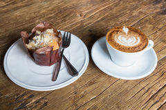 Hot latte with chocolate muffin Stock Photo