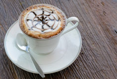 Hot latte coffee in cup. Royalty Free Stock Image