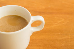 Hot latte coffee cup on wood background and texture. Royalty Free Stock Photos