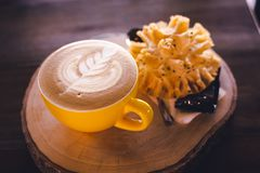 Hot Latte Coffee Cup. On wooden tray stock photography