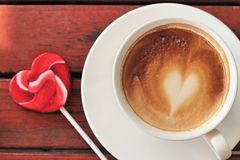 Hot latte coffee in glass and candy sweet valentines heart Royalty Free Stock Images