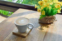 Hot latte coffee in glass cup mug on table. Hot latte coffee in glass cup mug on wooden table stock images
