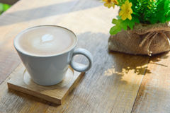 Hot latte coffee in glass cup mug. On wooden table royalty free stock photos