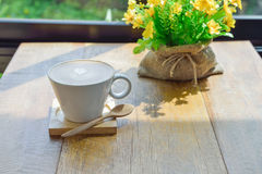 Hot latte coffee in glass cup mug. On wooden table stock image