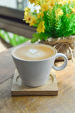 Hot latte coffee in glass cup mug on wooden. Table stock images