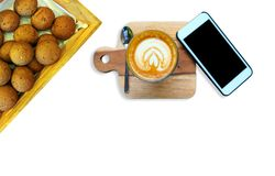 Hot latte coffee is placed on a wooden tray. Hot latte coffee is placed on a wooden tray royalty free stock photo