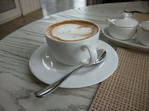 Hot Latte in love. A coffee latte in white cup Royalty Free Stock Images