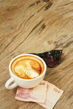 Hot latte , sunglasses with money of Thai Bath. Stock Photography