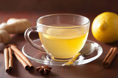 Hot lemon ginger cinnamon tea in glass cup Stock Photography