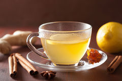Hot lemon ginger cinnamon tea in glass cup Royalty Free Stock Photography