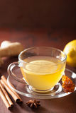Hot lemon ginger cinnamon tea in glass cup Stock Photos