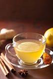 Hot lemon ginger cinnamon tea in glass cup.  Stock Photos