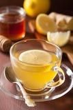 Hot lemon ginger honey tea in glass cup Stock Photos