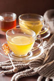 Hot lemon ginger honey tea in glass cup Stock Photo