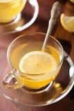 Hot lemon ginger tea in glass cup Stock Photos