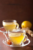 Hot lemon ginger tea in glass cup Royalty Free Stock Photo