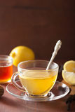 Hot lemon ginger tea in glass cup Stock Image