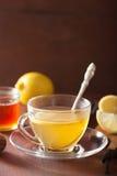 Hot lemon ginger tea in glass cup Stock Image