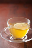 Hot lemon ginger tea in glass cup Stock Photos