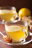 Hot lemon ginger tea in glass cup Stock Photography
