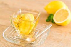 Hot lemon tea. A cup of hot lemon tea Royalty Free Stock Images