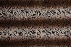 Hot leopard skin seamless background. Used as raw material for screen and print pattern royalty free stock images