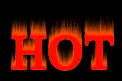 HOT letters on fire in black BG Stock Photo