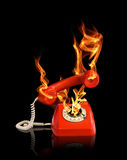 Hot line phone in fire. Flames black backround Stock Images