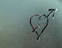 Hot love on a cold surface Stock Images