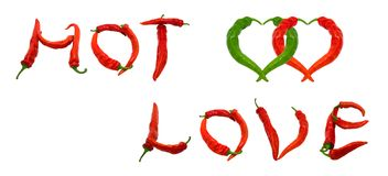 HOT LOVE text and two hearts composed of chili peppers Royalty Free Stock Photos