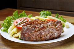 Hot lunch plate. Lunch with vegetables and roasted meat Royalty Free Stock Image
