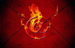 Hot mail. E mail symbol with flames on red background Stock Photos