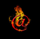 Hot mail. E mail symbol with flames on black background Stock Photography