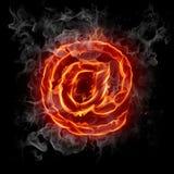 Hot mail. Burning at symbol on black background Stock Image