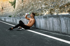 Hot Man Pouring Refreshing Water Over Face After Exercising Outd Stock Photo