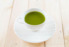 Hot matcha. On wood background - soft focus with vintage film filter Stock Photos