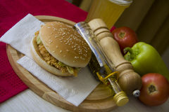 Hot meal with beer and hamburger Stock Photography