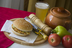 Hot meal with beer and hamburger Royalty Free Stock Photos