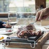 Hot meat on baking stone Royalty Free Stock Photo