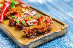 Hot meat dish - Fried chicken legs with curry sauce and red pepper Royalty Free Stock Photo