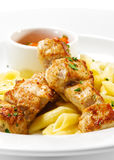 Hot Meat Dish - Grilled Pork with Pasta Penne. And Red Chile Sauce Royalty Free Stock Image