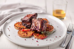 Hot Meat Dishes. Pork ribs grilled with peppers and apples Royalty Free Stock Images