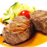 Hot Meat Dishes - Veal Medallions. With Zucchini and Cherry Tomato Royalty Free Stock Images